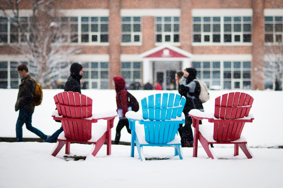 Students walk through campus during a snow storm on March 21, 2016. Photo by Adam Glanzman/Northeastern University